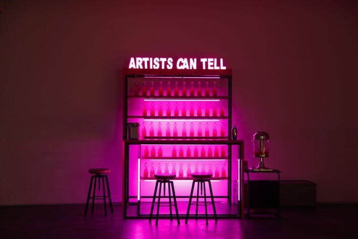 Wang Xin, Artists Can Tell, 2016, Table, chairs, signboard, LED lights, custom bottles, Kool Aid, vodka, 200 x 140 x 160 cm